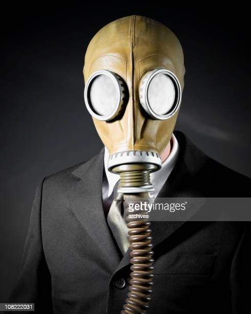 Businessman Wearing Gas Mask on Black Background