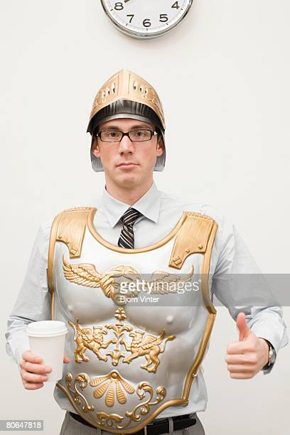 businessman wearing gladiator armor - gladiator stock photos and pictures