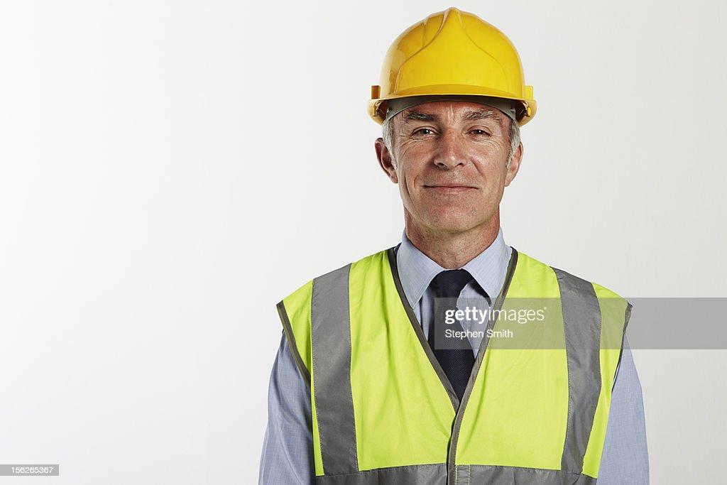 Businessman wearing hard hat and high vis jacket : Foto de stock