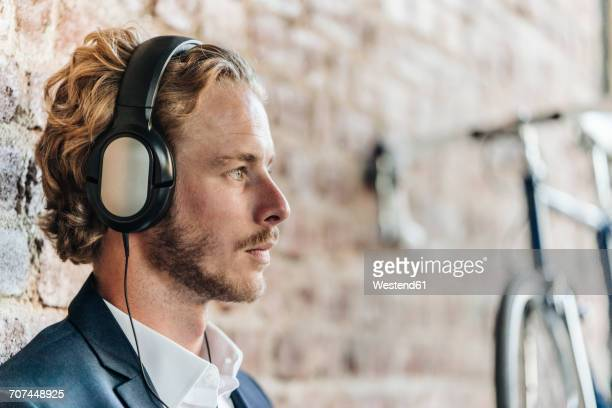 Businessman wearing headphones