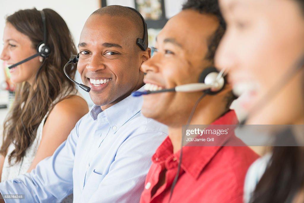 Businessman wearing headset in office : Foto stock