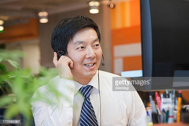 Businessman Wearing Headset in the Office