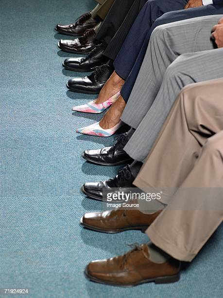 Businessman wearing high heels