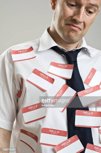 Businessman Wearing Label Stickers