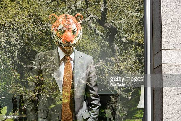 Businessman wearing mask in office with reflection