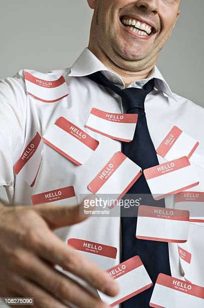 Businessman Wearing Name Tag Labels Holding Hand Out