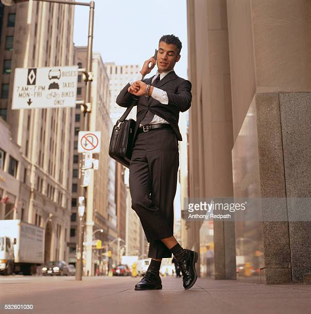 Businessman Wearing Small Suit and Waiting