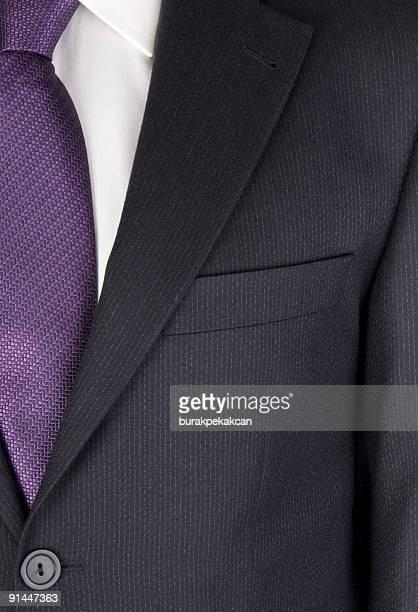 ビジネスマンを合わせてスーツ、中央部分、フルフレーム、クローズアップ