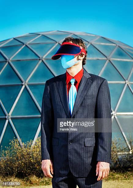 Businessman wearing visor and mask