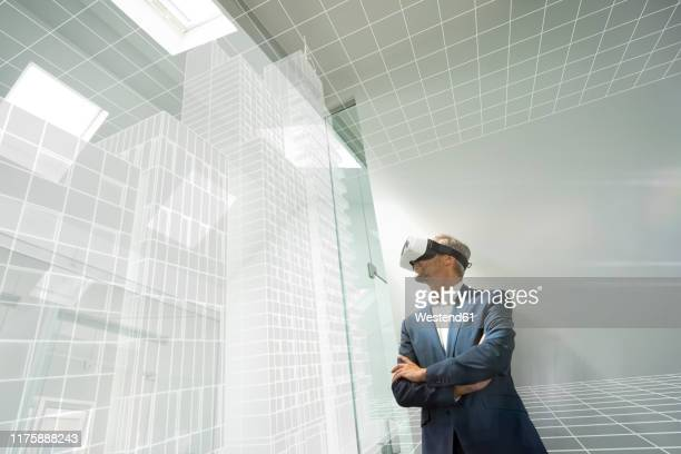 businessman weraing vr goggles, looking at virtual architcture - cyberspace stock pictures, royalty-free photos & images
