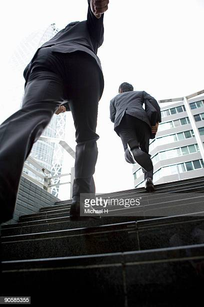 Businessman who goes up in the stairs running