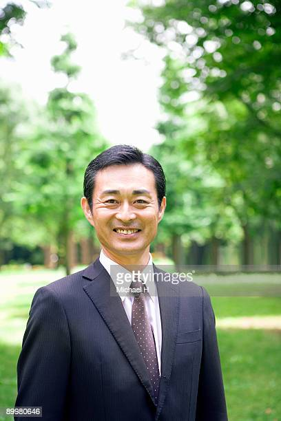 Businessman who is standing in park