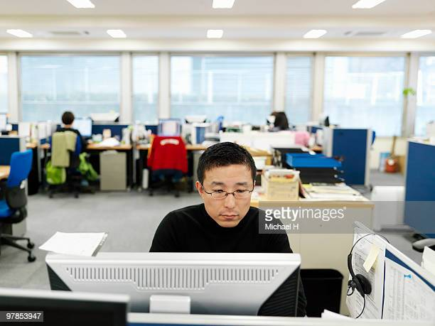 businessman who is working toward personal compute - business ストックフォトと画像
