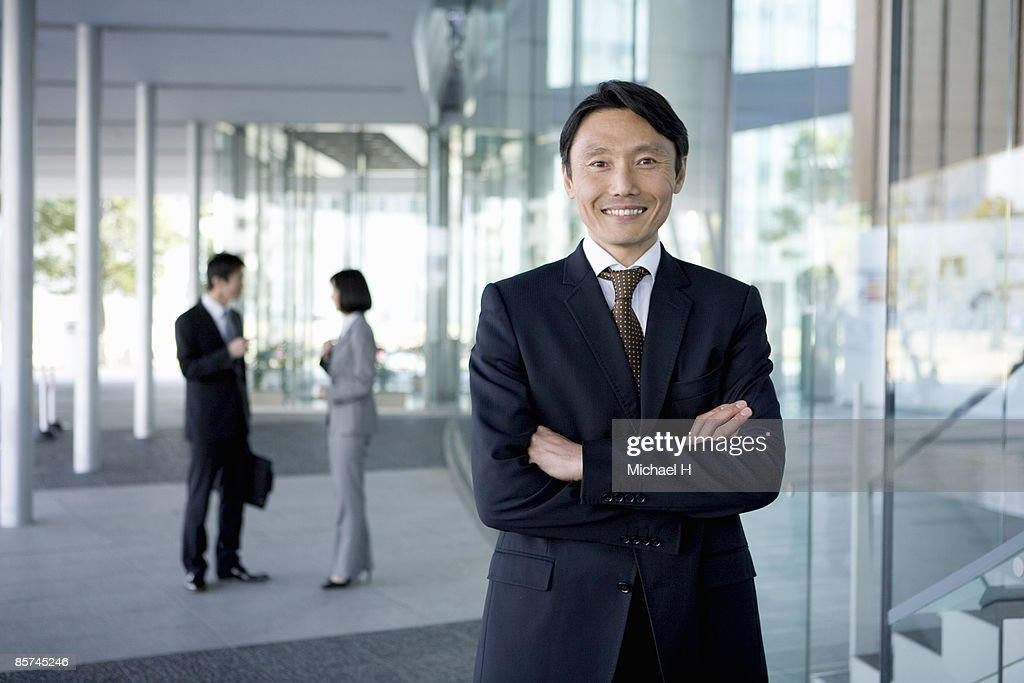 Businessman who overflowed in confidence : Stock Photo