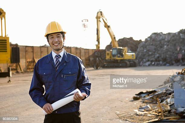 Businessman who put on helmet and uniform