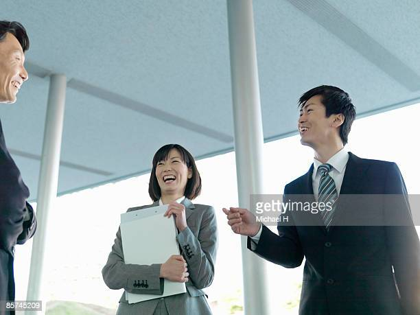 Businessman who talks happily with superior