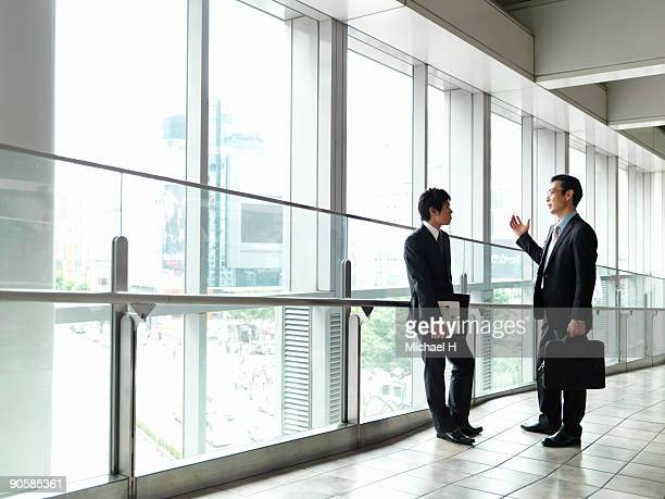 Businessman who talks with subordinate in entrance