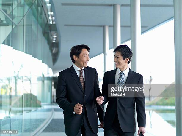 businessman who walks with superior - two people ストックフォトと画像