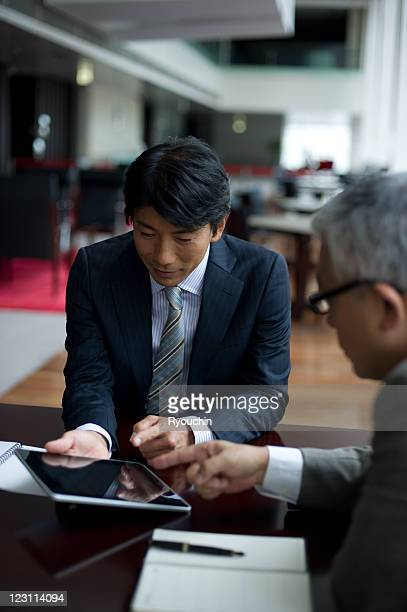 businessman who works by using tablet in office