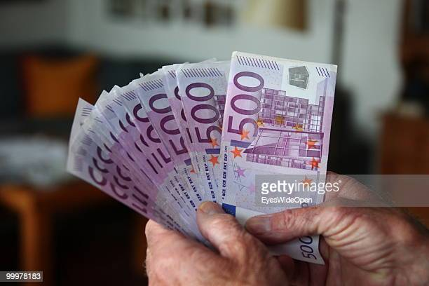 Businessman with 500 Euro banknotes. On May 09, 2010 in Munich, Germany.