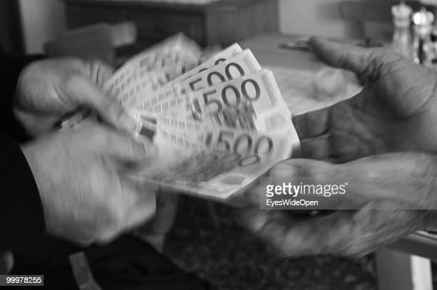 Businessman with 500 Euro banknotes on May 09 2010 in Munich Germany