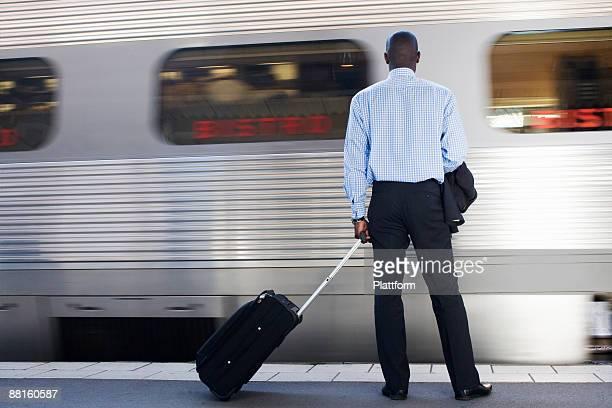 A businessman with a bag at a train station Stockholm Sweden.