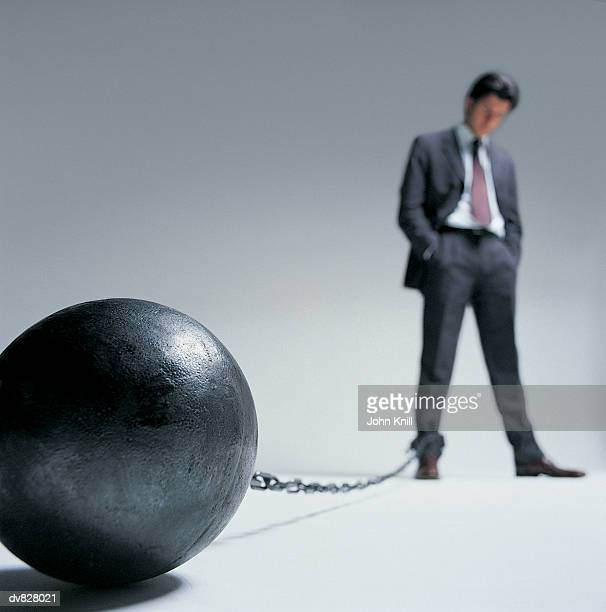 Businessman with a Ball and Chain