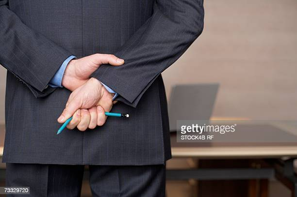 Businessman with a broken pencil in his hand