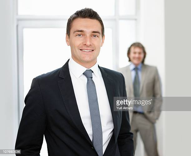 businessman with a colleague in background - number of people stock photos and pictures