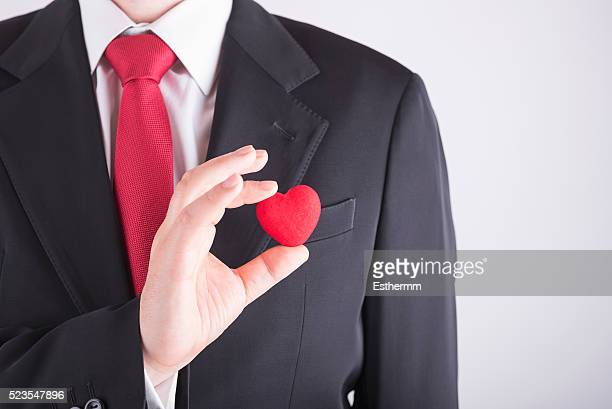 businessman with a heart in his hand