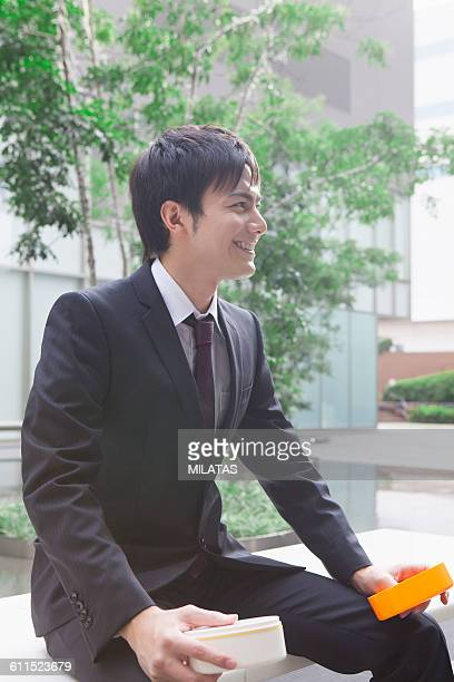 businessman with a lunch box - ルーキー ストックフォトと画像