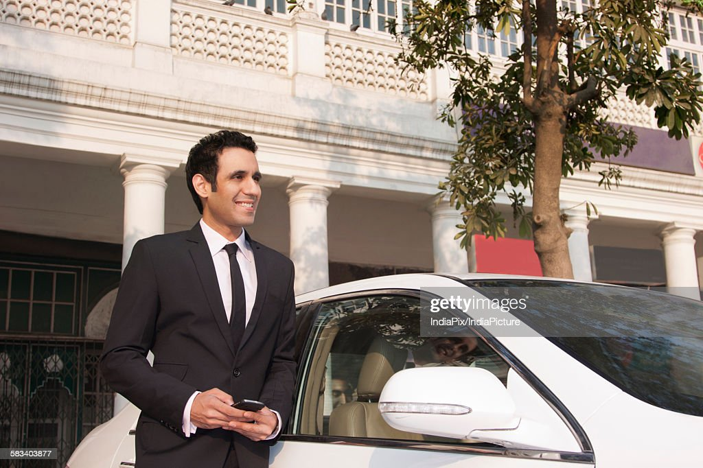 Businessman with a mobile phone , INDIA , DELHI : Stock Photo