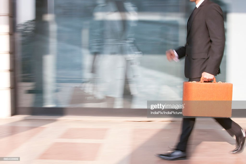 Businessman with a suitcase walking , INDIA , DELHI : Stock Photo
