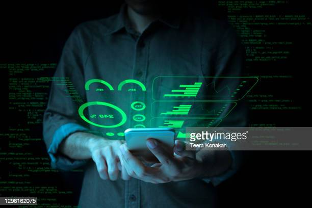 businessman with a tablet is showing a growing virtual hologram stock and finance and investment concept.money management and financial chart. - stock trader stock pictures, royalty-free photos & images