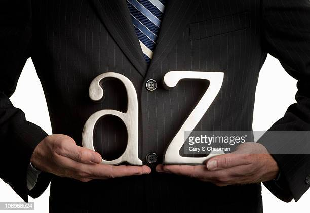 Businessman with A to Z letters