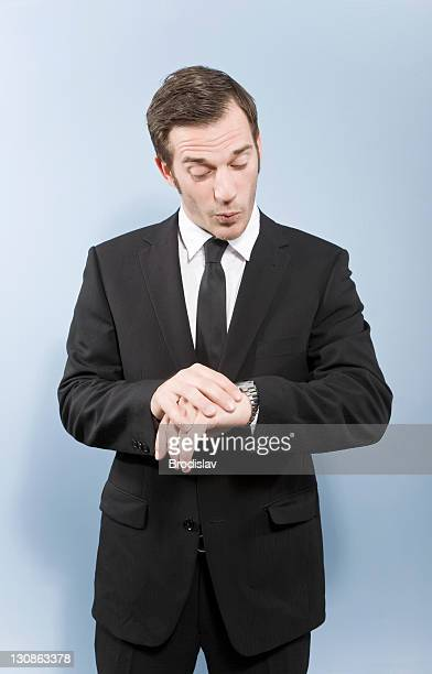 businessman with a watch - cut wrists stock photos and pictures