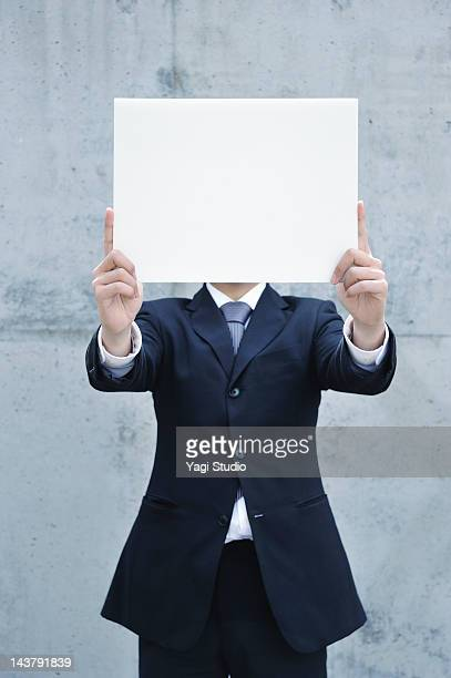 Businessman with a white board