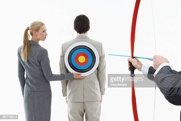 Businessman with Archery Target on His Back