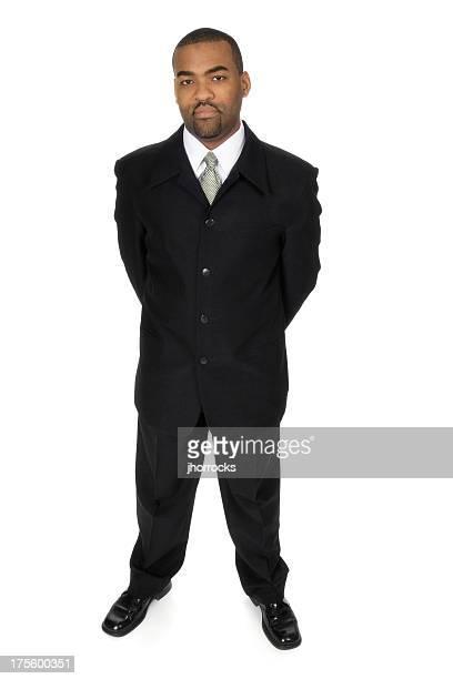 Homme d'affaires avec les bras derrière son dos