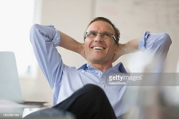 businessman with arms behind his head - hands behind head stock pictures, royalty-free photos & images