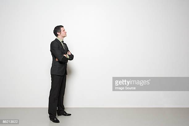 businessman with arms crossed - mid adult men stock pictures, royalty-free photos & images