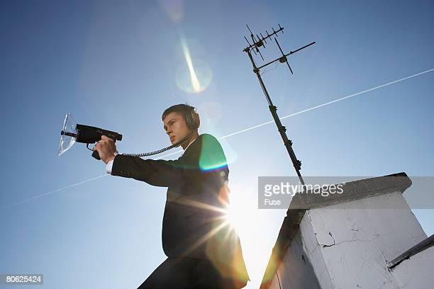 Businessman with Audio Surveillance Equipment