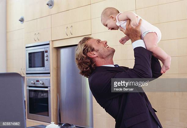 Businessman with baby in the kitchen