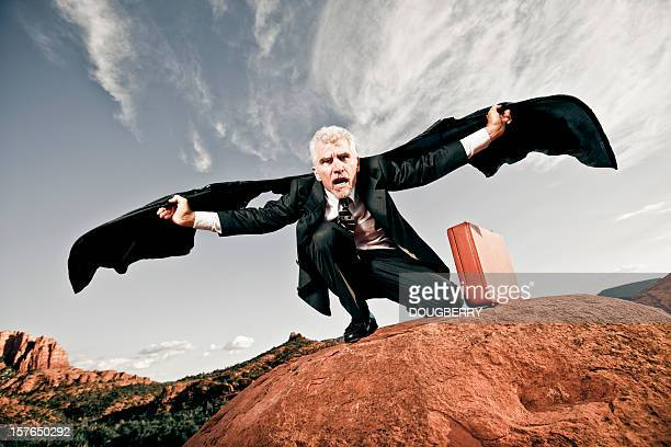 businessman with bat wings - arizona bird stock pictures, royalty-free photos & images