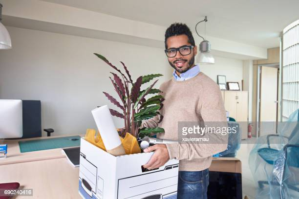 businessman with belongings in office - belongings stock photos and pictures