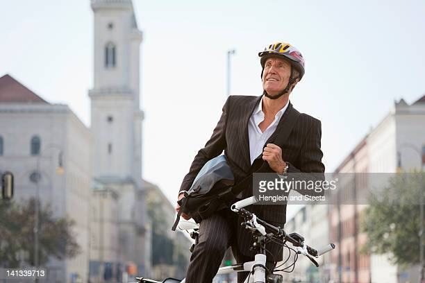 Businessman with bicycle on city street