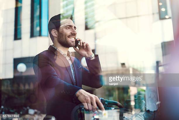 Businessman with bicycle on the phone