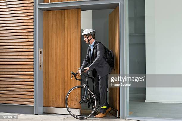 businessman with bicycle - day of doors stock pictures, royalty-free photos & images