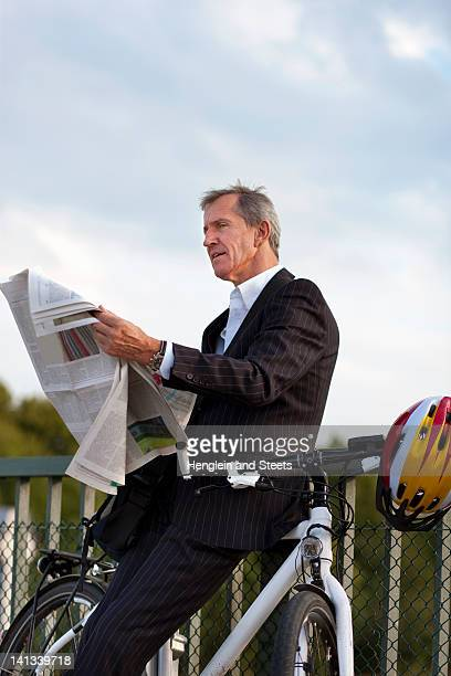 Businessman with bicycle reading