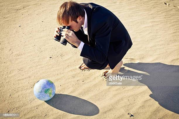 businessman with binoculars searching the globe - see through clothes models stock pictures, royalty-free photos & images